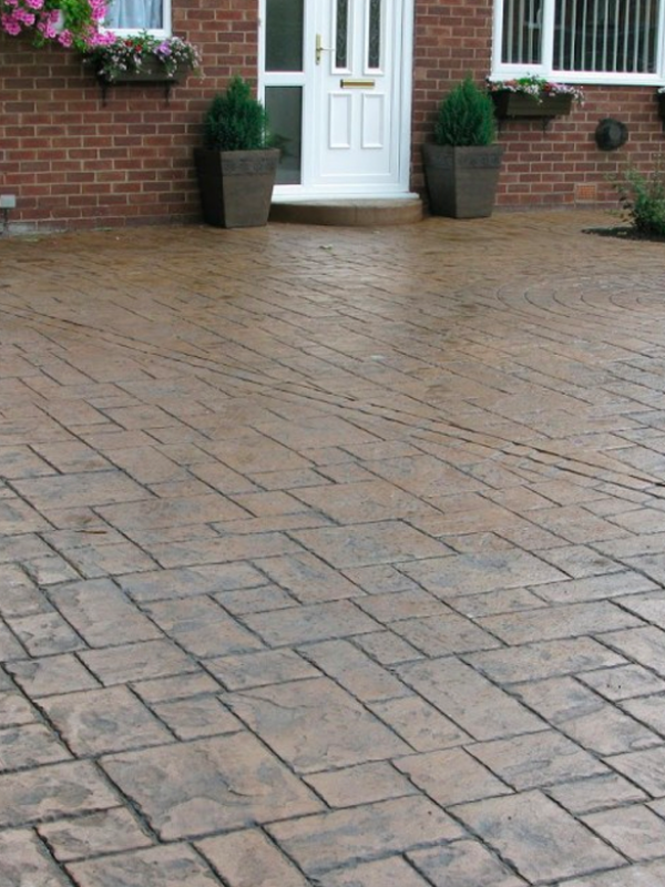 Stamped Concrete driveway stained Brown